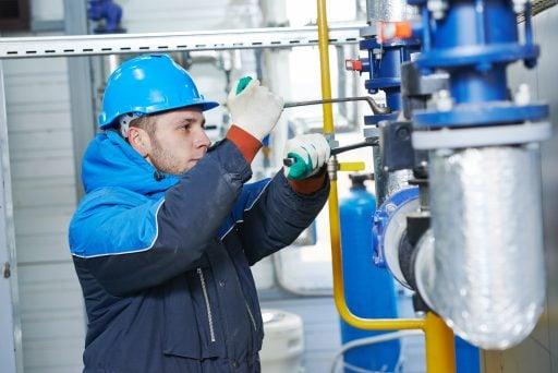 technician worker of heating system in boiler room installation